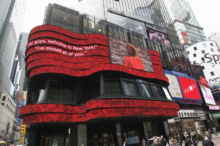 ALI FEDOTOWSKY ON SIGN IN TIMES SQUARE