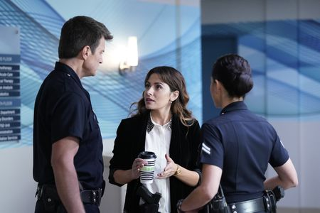 NATHAN FILLION, SARAH SHAHI